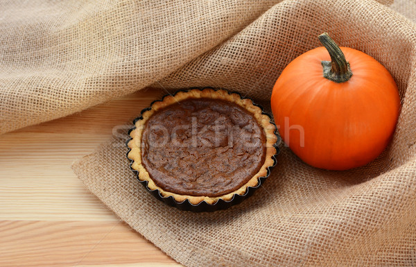 Pumpkin pie and pumpkin in hessian Stock photo © sarahdoow