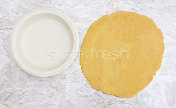 Fresh pastry rolled out in a circle to line pie dish Stock photo © sarahdoow
