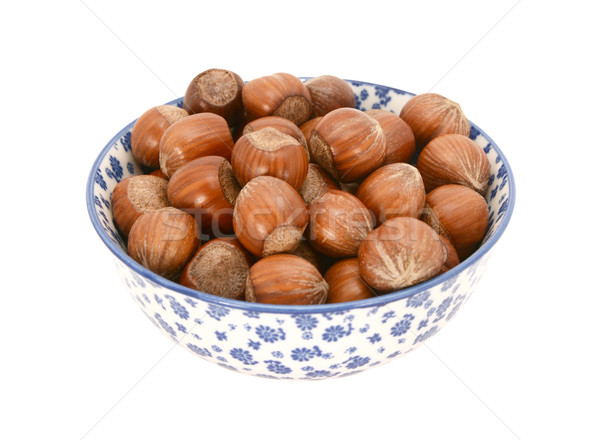 Hazelnuts in a blue and white china bowl Stock photo © sarahdoow