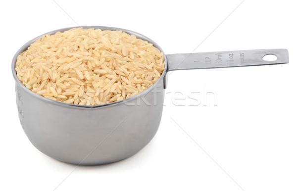 Long grain brown rice in a measuring cup Stock photo © sarahdoow