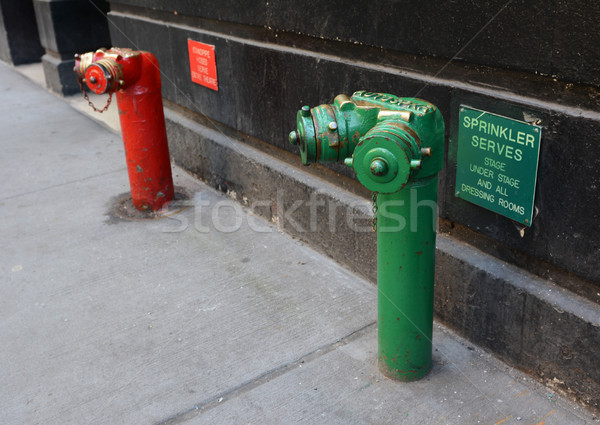 Red and green siamese standpipes Stock photo © sarahdoow