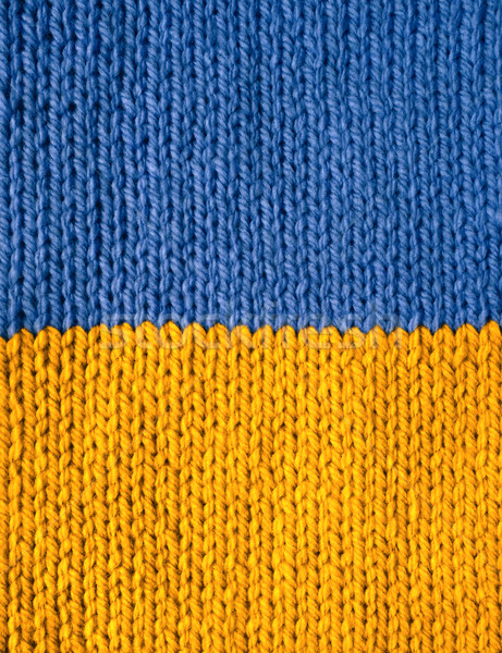 Stockinette stitch knitting in blue and yellow yarn Stock photo © sarahdoow