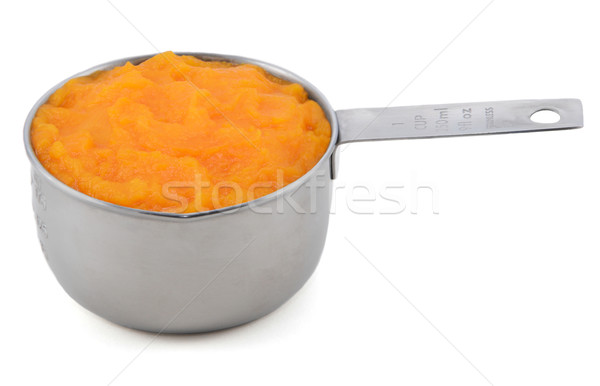 Pureed pumpkin in a measuring cup Stock photo © sarahdoow
