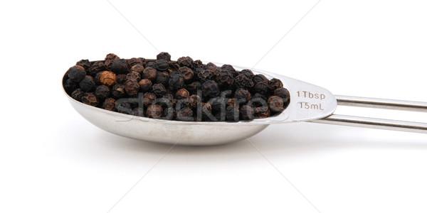 Black peppercorns measured in a metal tablespoon Stock photo © sarahdoow