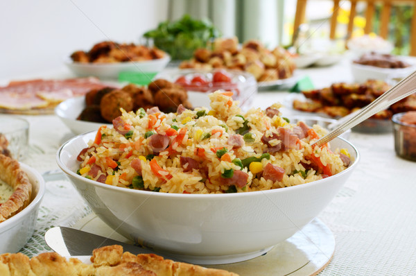 Bowl of rice salad on a buffet table Stock photo © sarahdoow