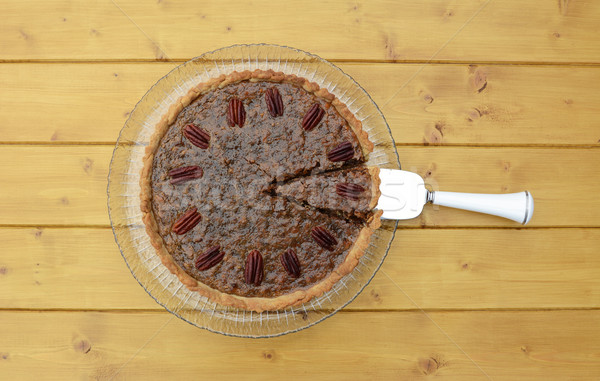 Pie server with cut slice in a traditional pecan pie Stock photo © sarahdoow