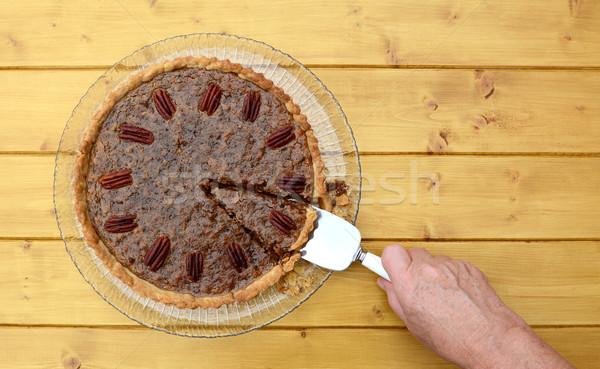 Woman serves a slice of pecan pie Stock photo © sarahdoow