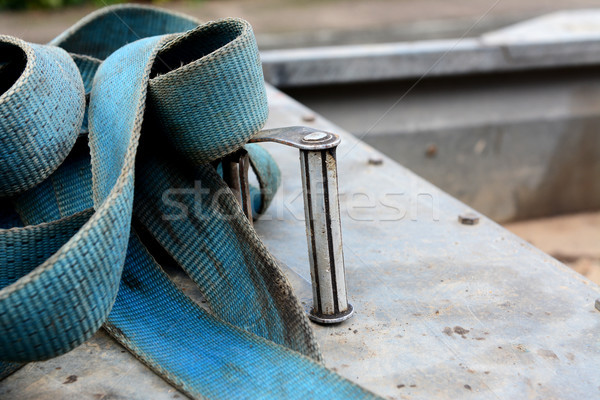 Detail of metal buckle on a blue ratchet strap Stock photo © sarahdoow