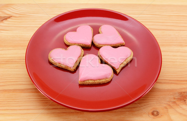 Five heart-shaped iced cookies on a red plate  Stock photo © sarahdoow