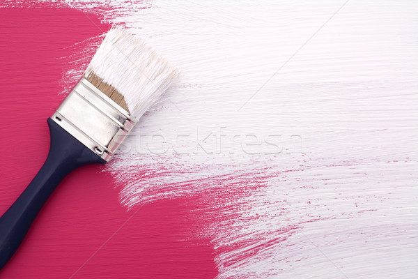 Paintbrush with white paint painting over pink Stock photo © sarahdoow