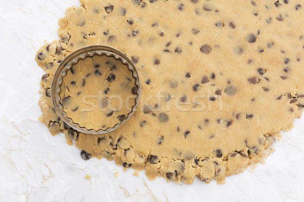 Cookie cutter on rolled out chocolate chip cookie dough Stock photo © sarahdoow