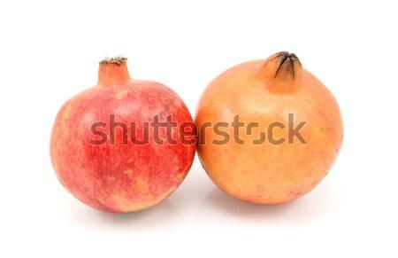 Two pomegranates, red and yellow Stock photo © sarahdoow