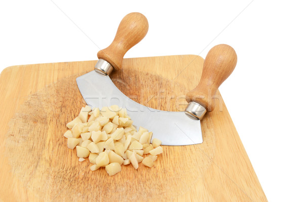 Coarsely chopped macadamia nuts with a rocking knife Stock photo © sarahdoow