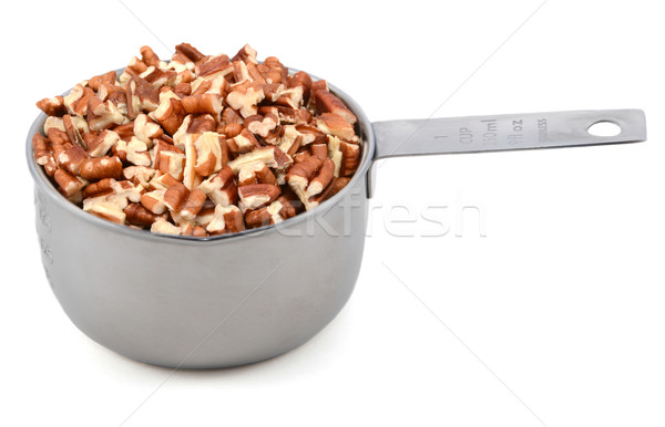Chopped pecan nuts in a metal cup measure Stock photo © sarahdoow