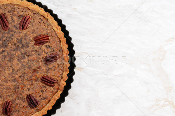 Freshly baked pecan pie in the baking tin Stock photo © sarahdoow