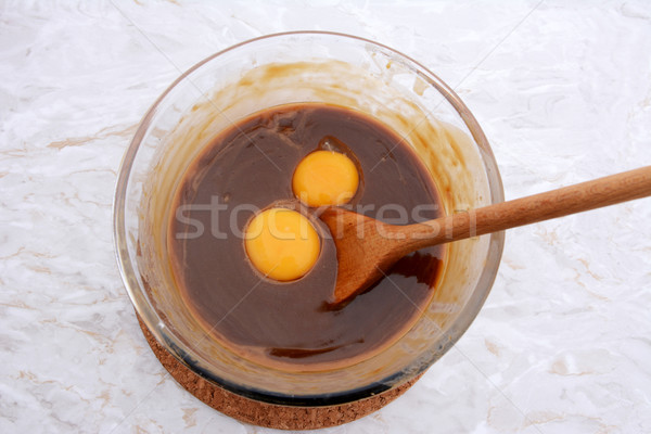 Stirring egg yolks into pecan pie filling Stock photo © sarahdoow