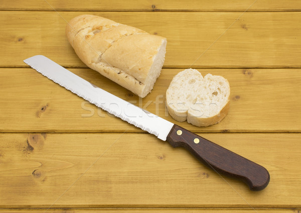 Portion of baguette with a slice cut off Stock photo © sarahdoow