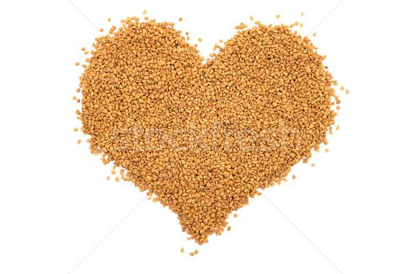 Dried fenugreek seeds in a heart shape Stock photo © sarahdoow