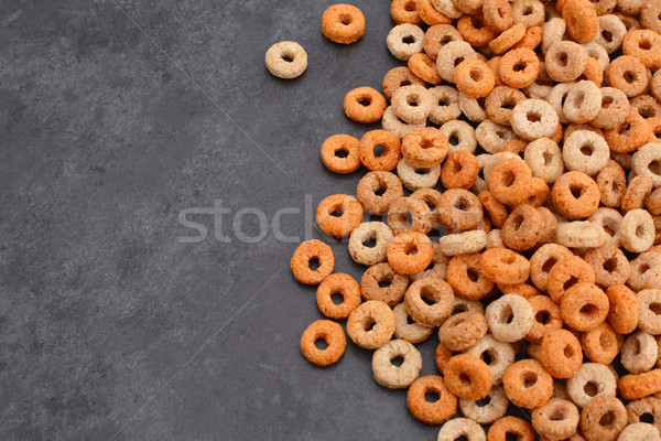 Multigrain hoops breakfast cereal on grey slate background Stock photo © sarahdoow