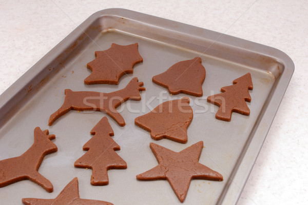 Cookie sheet with uncooked festive gingerbread biscuits Stock photo © sarahdoow