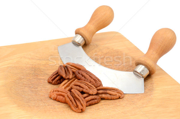 Pecan nuts with a rocking knife Stock photo © sarahdoow