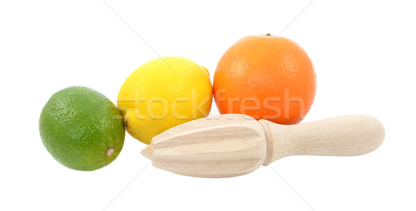 Lime, lemon and orange fruit with wooden citrus reamer Stock photo © sarahdoow