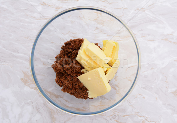 Pats of butter with dark soft sugar in a bowl Stock photo © sarahdoow