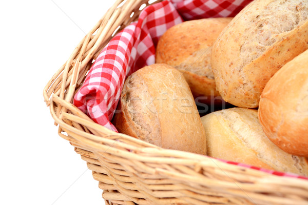 Stock photo: Closeup of fresh bread rolls in a wicker basket