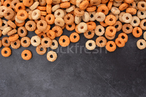 Multigrain hoops breakfast cereal border on dark grey slate Stock photo © sarahdoow
