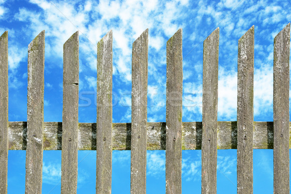 old wooden fence with cloudy sky Stock photo © Sarkao