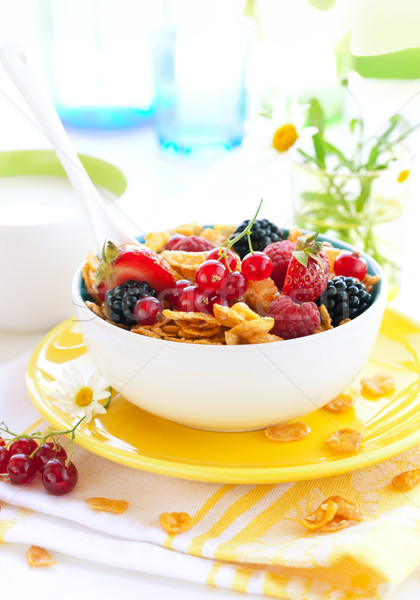 Bowl of cornflakes with milk and fruits Stock photo © sarsmis