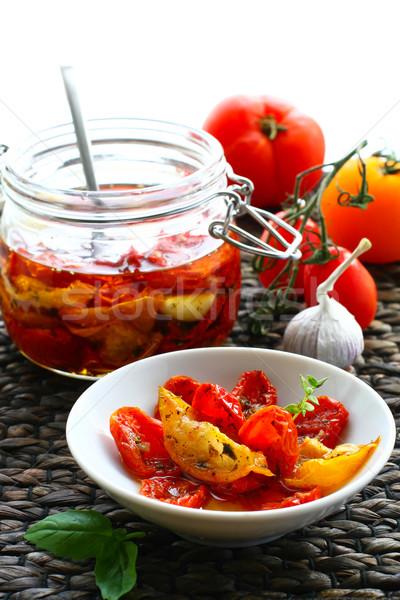Dried tomatoes in olive oil  Stock photo © sarsmis