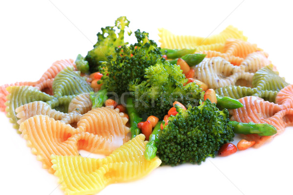 pasta farfalle tricolore with asparagus, broccoli and nuts Stock photo © sarsmis