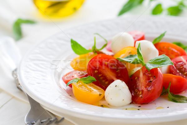 салат Капрезе моцарелла помидоров свежие базилик томатный Сток-фото © sarsmis