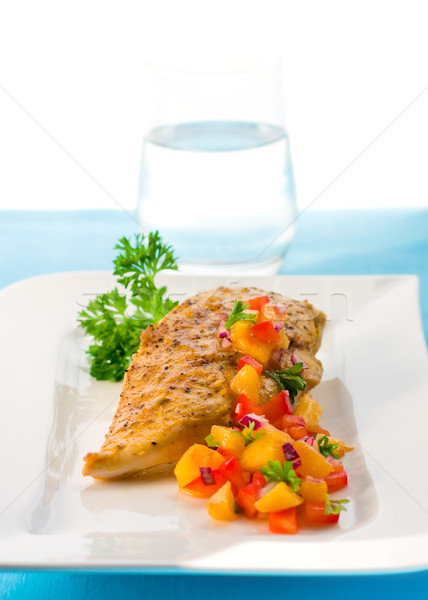 Stock photo: chicken with mango salsa