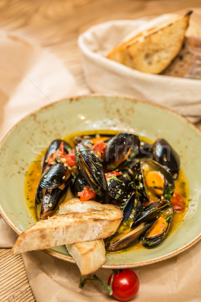 Moules Marinieres - Mussels cooked with white wine sauce. Stock photo © sarymsakov