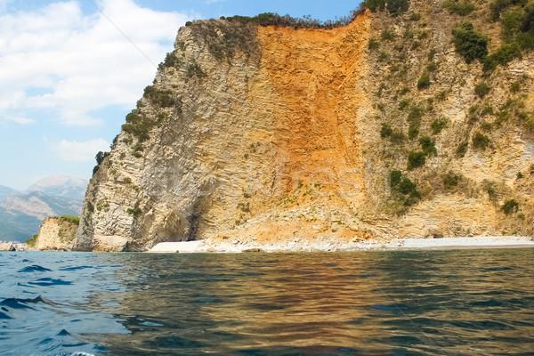 Kövek átlátszó óceán víz Montenegró épület Stock fotó © sarymsakov
