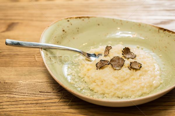 Italian risotto with black truffle Stock photo © sarymsakov