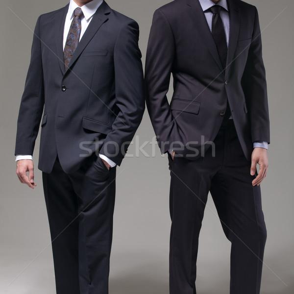 Iki adam zarif takım elbise karanlık moda arka plan Stok fotoğraf © sarymsakov