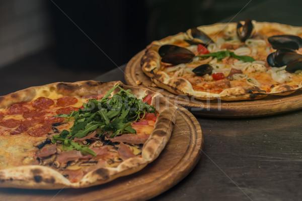 Finom olasz pizza felszolgált asztal szelektív fókusz Stock fotó © sarymsakov