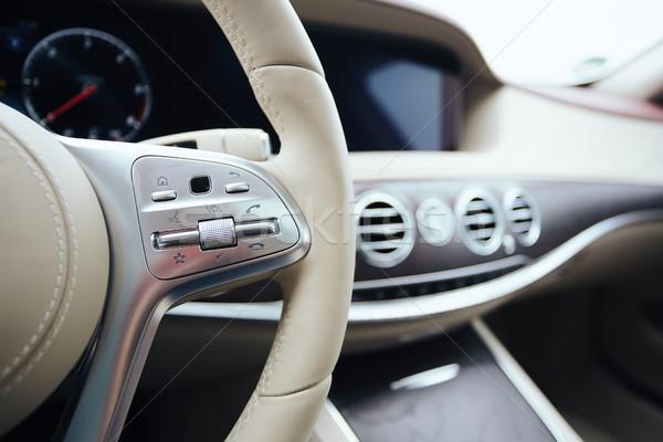 Control buttons on steering wheel. Car interior. Stock photo © sarymsakov