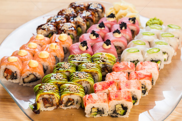 Ayarlamak Japon sushi beyaz plaka balık Stok fotoğraf © sarymsakov