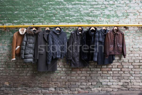 Men's trendy clothing on hangers Stock photo © sarymsakov