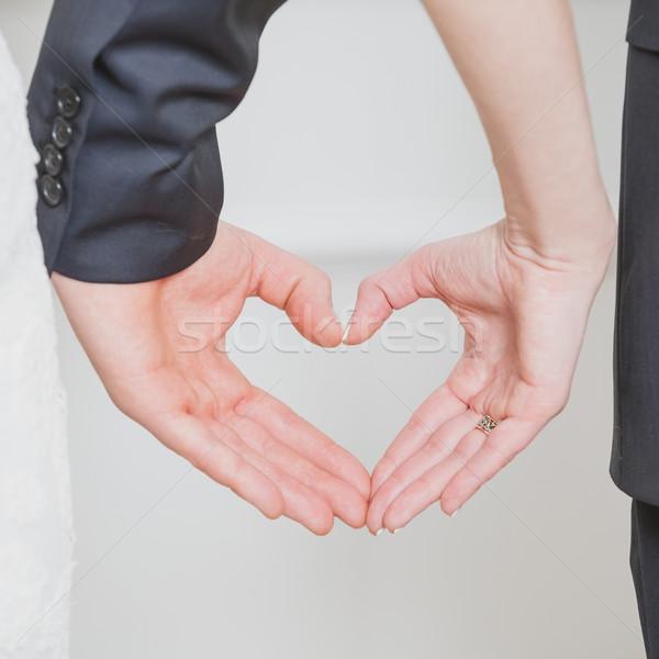 Esküvő pár mutat forma szív kezek Stock fotó © sarymsakov