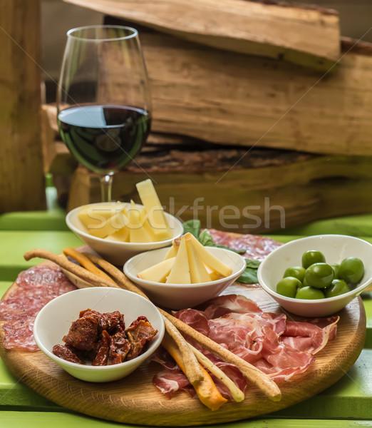 different italian antipasti and red wine Stock photo © sarymsakov