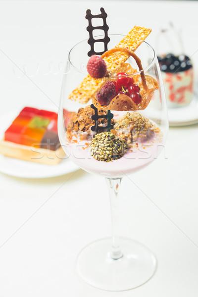 Közelkép csokoládé elegáns szemüveg málna joghurt Stock fotó © sarymsakov