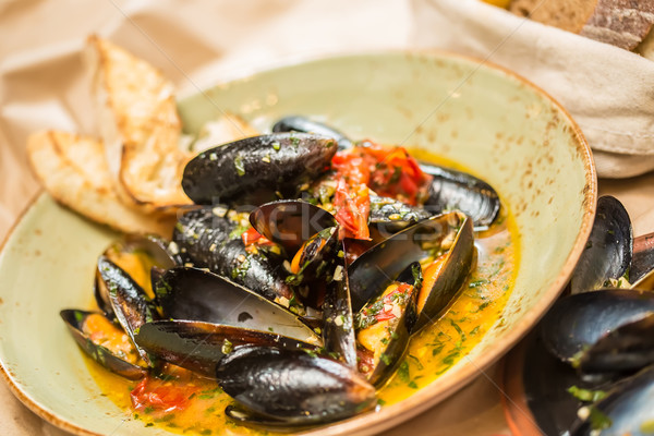 Stock photo: Moules Marinieres - Mussels cooked with white wine sauce.