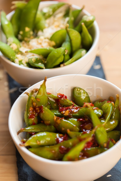 Green string beans chinese dish with spices Stock photo © sarymsakov