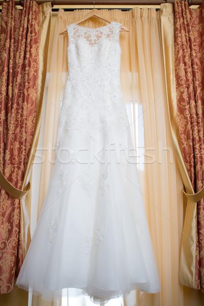 Esküvői ruha akasztás ablak hotelszoba esküvő divat Stock fotó © sarymsakov