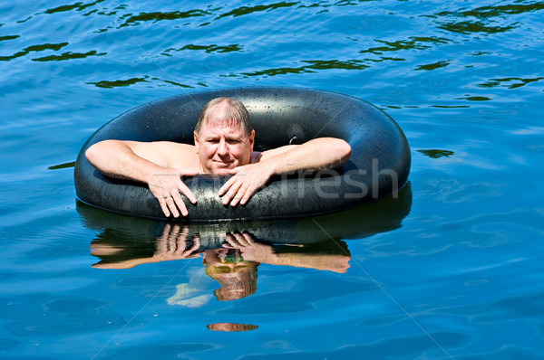 Man in Water with Tube Stock photo © sbonk